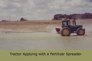 Tractor applying with a fertilizer spreader